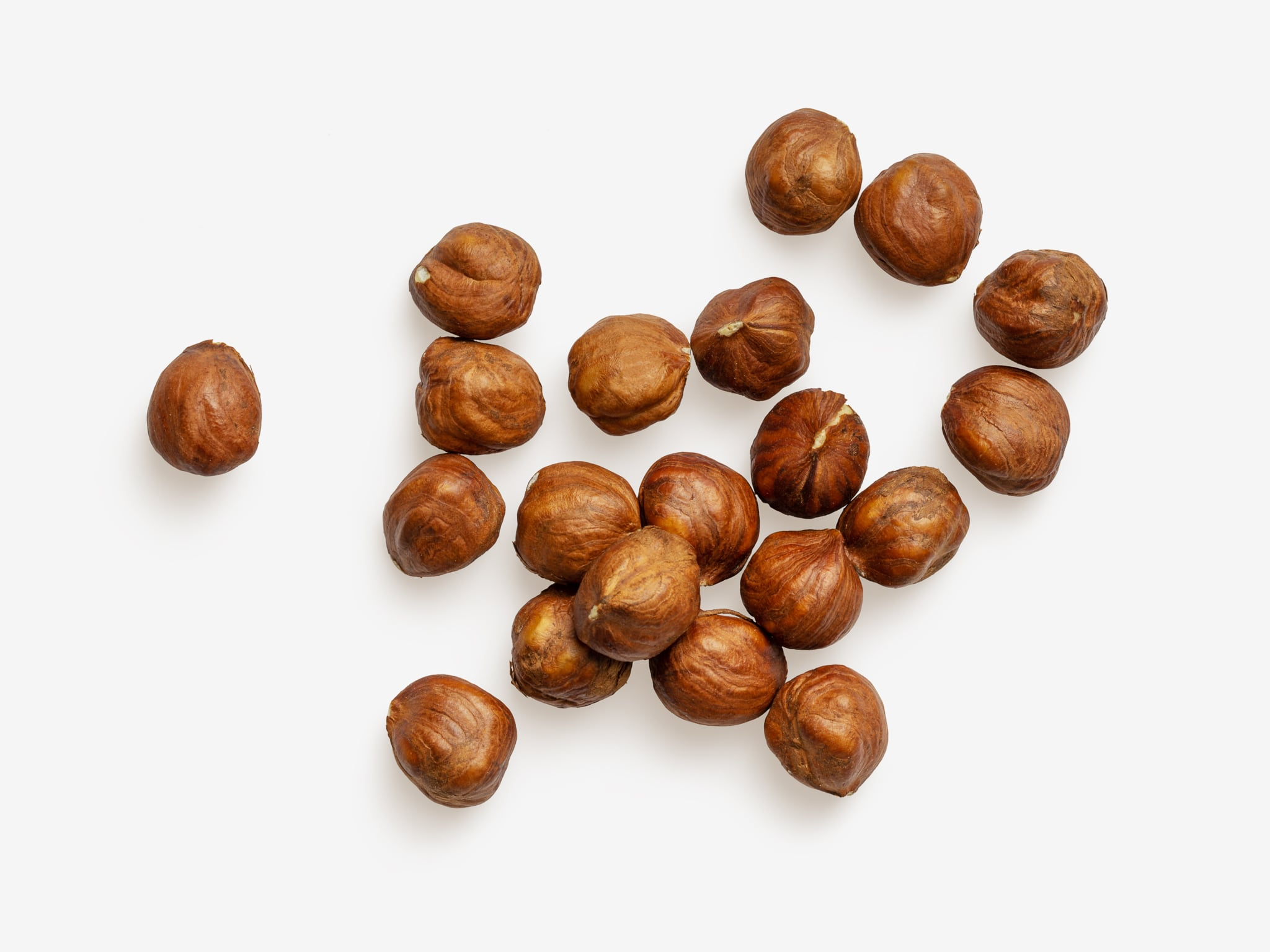 Clean Isolated PSD image of Hazelnut on transparent background with separated shadow