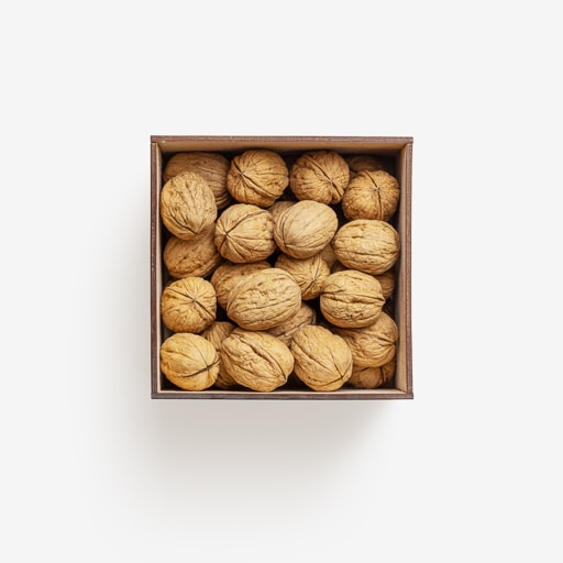 Clean Isolated PSD image of Box of walnuts on transparent background with separated shadow