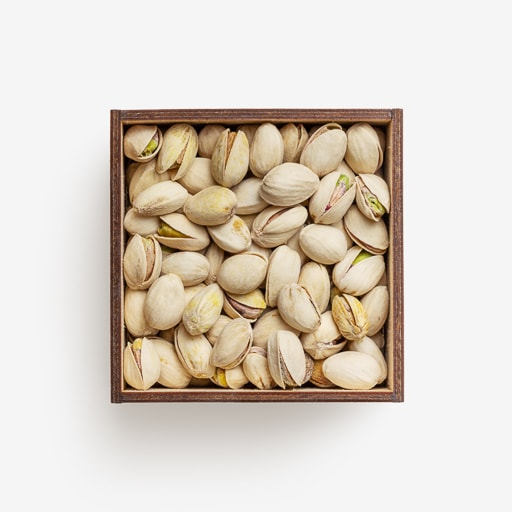 Clean Isolated PSD image of Box of pistachios on transparent background with separated shadow